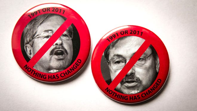 """Gov. Terry Branstad's administration illegally prohibited state employees from wearing pins that unfavorably show the governor, an administrative law judge has ruled. The pins, distributed by union leaders, shows an unflattering black and white photograph of Branstad's face bisected by a red diagonal slash with the words, """"NOTHING HAS CHANGED."""""""