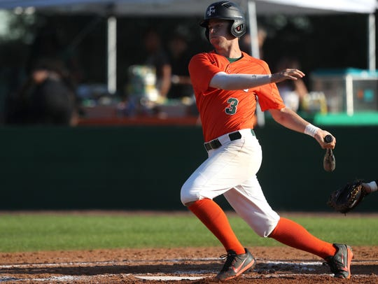 FAMU's Bret Maxwell hits a double against Brown during