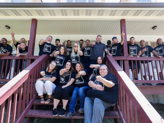 Residents of Hope Homes pose for a photograph outside