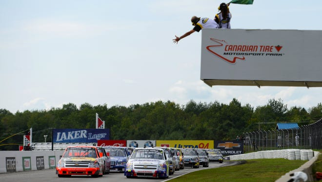 Ty Dillon (front left) leads Chase Elliott (front right) on the final restart of the NASCAR Camping World Truck Series race at the Canadian Tire Motorsports Park on Sept. 1.
