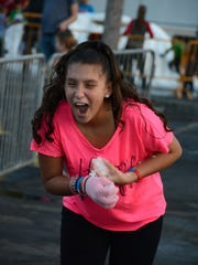 Kayla Zuluaga, 11, gets caught up in a snowball fight.