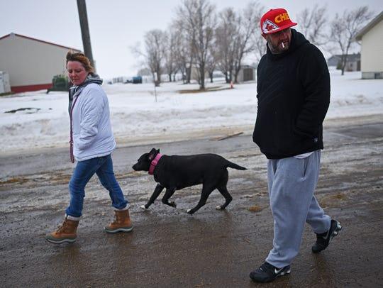 Dirk Sparks and Stefanie Salvas walk Jade the dog Thursday,