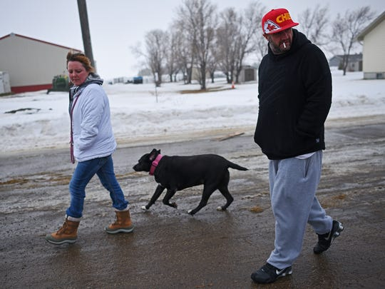 Dirk Sparks and Stefanie Salvas walk Jade the dog Thursday,