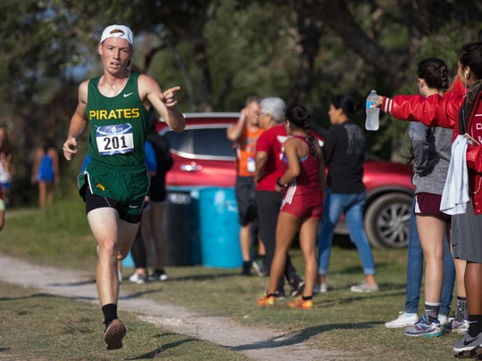 Runners compete in the varsity boys race during the District 31-4A cross country meet at Live Oak Park in Ingleside on Thursday, Oct. 12, 2017.