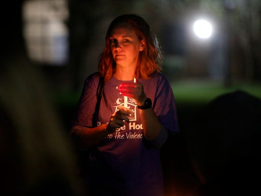 Attendees light candles in memory of those who lost their lives to domestic violence at the annual Domestic Violence Awareness Month Candlelight Vigil and Survivor Speak-Out held  during a previous year at TCC's Workforce Development Center. This year's event is from 6-8 p.m. Oct. 15.