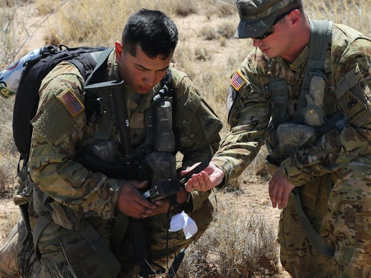 A flight crew from the 2nd Battalion, 501st Aviation Regiment works to establish radio communication after a field training exercise simulated that a Chinook helicopter was shot down.