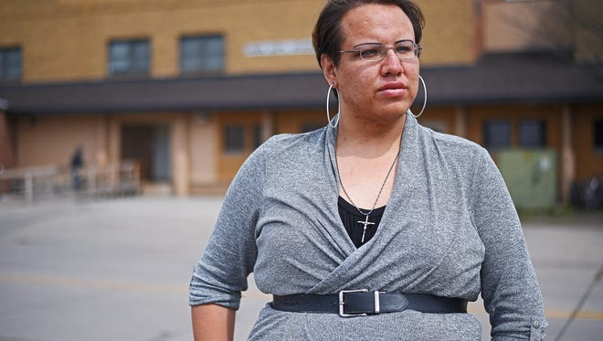 Isabella Red Cloud, a transgender woman, poses for a portrait Monday, April 24, 2017, across the street from the Union Gospel Mission in Sioux Falls. Red Cloud said she was turned away from breakfast at the Union Gospel Mission because she was wearing a dress.