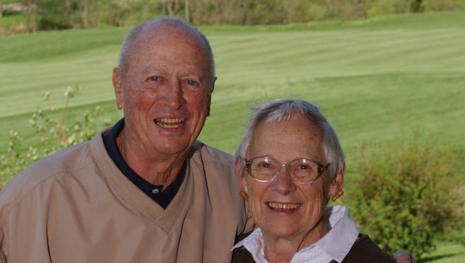 Johnny Orr with his wife Romie.