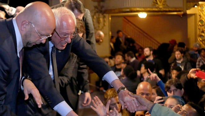 Bernie Sanders shakes hands with supporters after speaking at the Apollo Theater in Harlem April 9, 2016.