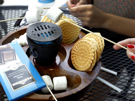 Italian-style Tableside S'mores at Fresco Italian Cafe on the Canal, with Italian waffle cookies and Italian chocolate.