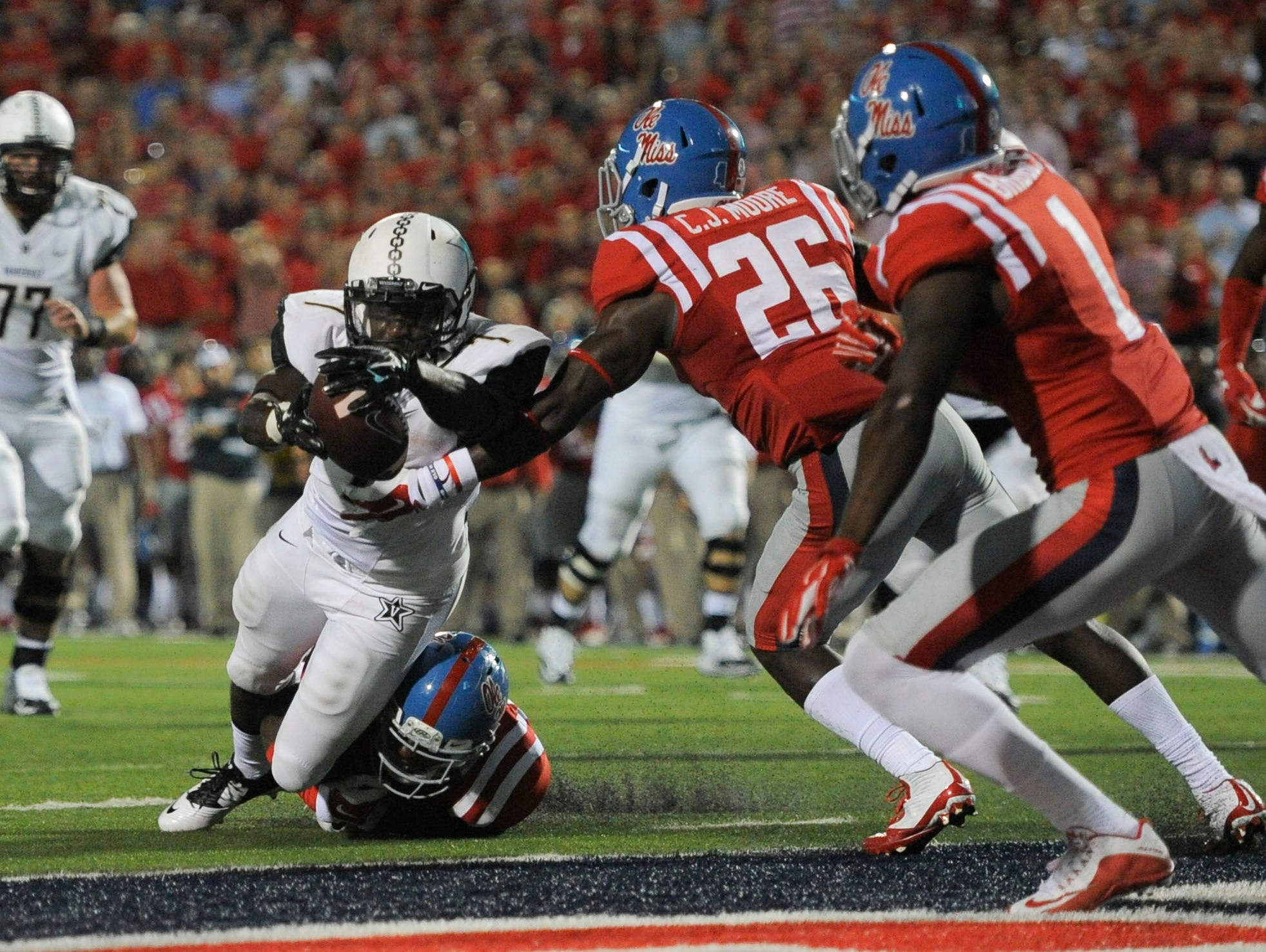 Vanderbilt running back Ralph Webb (7) dives into the end zone for a touchdown at Ole Miss on Sept. 26, 2015.