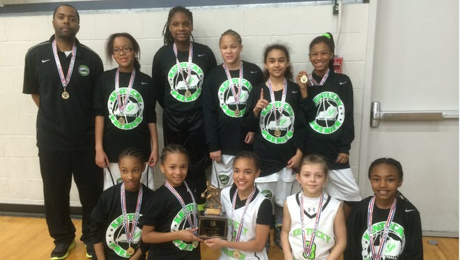 """Back row left to right: Coach Michael Moore Jr., Darian Griggs, Oyshia Stiff, Tyra Flowers, Amaya Asher, Anya Winburn Front row left to right: Aries Harris, Makya Grinter, Kynidi Stiverson, Audrey Whitworth, Jaileyah Cotton. Not pictured: Katherine Reburn, Dorothy Gorman, Isabel Grimes."""" alt=""""Back row left to right: Coach Michael Moore Jr., Darian Griggs, Oyshia Stiff, Tyra Flowers, Amaya Asher, Anya Winburn Front row left to right: Aries Harris, Makya Grinter, Kynidi Stiverson, Audrey Whitworth, Jaileyah Cotton. Not pictured: Katherine Reburn, Dorothy Gorman, Isabel Grimes."""