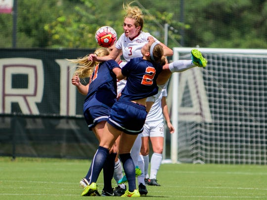 Megan Connolly (3) leaps for a header during the Florida