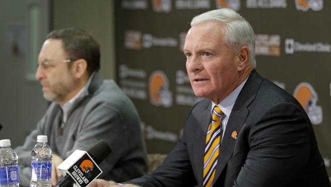 Browns owner Jimmy Haslam, right, and president Joe Banner address reporters Monday.