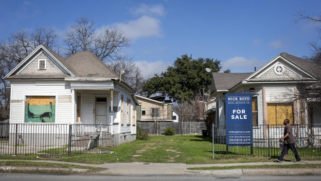 A new home goes up next to a much older -- and smaller -- house in East Austin. As gentrification continues in parts of Austin, the city is seeing more Black and Hispanic residents moving to the suburbs, according to new data from the U.S. Census Bureau.