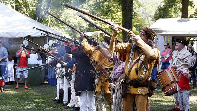 The Militia and Mountain Men fire a volley of gunshots during the opening of a previous year's Yankee Peddler Festival at Clay's Park Resort in Lawrence Township. The 48th annual fest slated to start Sept. 12 has been canceled due to the COVID-19 crisis.