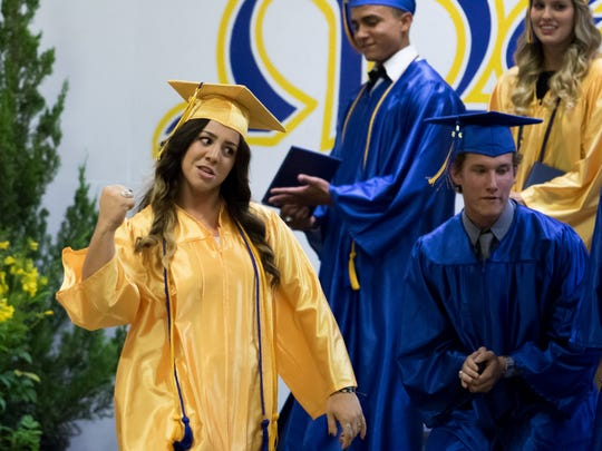 Lakyn Coppedge reacts with a fist pump upon hearing her name called to receive her diploma at Mesilla Valley Christian School's graduation.