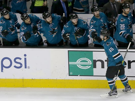 San Jose Sharks' Daniel O'Regan (65) celebrates with teammates after scoring a goal against the Calgary Flames during the third period of an NHL hockey game in San Jose, Calif., Saturday, April 8, 2017. The Sharks won 3-1. (AP Photo/Jeff Chiu)