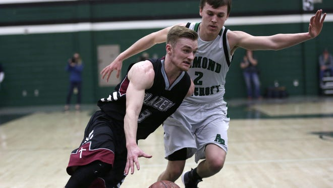 N.E.W. Lutheran's Nathaniel Schaefer attempts to dribble around Almond-Bancroft's Wyatt Richmyre during a WIAA Division 5 sectional championship game Saturday at D.C Everest High School in Schofield.