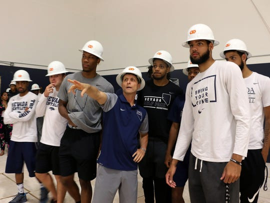 Head coach Eric Musselman and his players check out