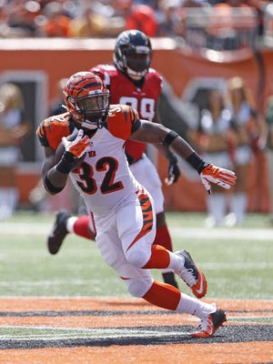 Cincinnati Bengals running back Jeremy Hill (32) breaks a run against the Atlanta Falcons during the first quarter of their game played at Paul Brown Stadium.