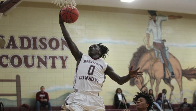 Madison County's Travis Jay skies for a layup during a 72-36 win over Crossroad Academy on Tuesday.