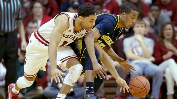 Indiana Hoosiers guard James Blackmon Jr. (1) steals the ball from Michigan Wolverines guard Muhammad-Ali Abdur-Rahkman (12) in the first half of their game. The Indiana Hoosiers play the Michigan Wolverines Sunday, February 8, 2015, afternoon at Assembly Hall in Bloomington IN.
