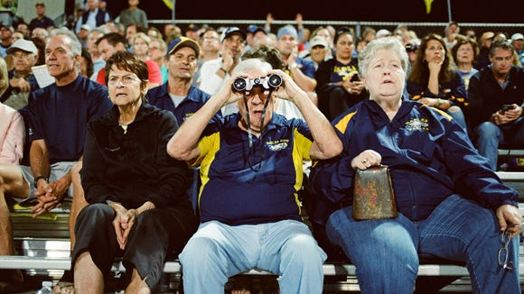 Fans focus on the action from the bleachers as the Naples Golden Eagles take on the Largo Packers on Nov. 17, 2017.