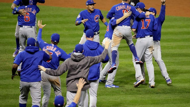 The Chicago Cubs celebrate after Game 7 of the World Series against the Cleveland Indians on Thursday in Cleveland. The Cubs won 8-7 in 10 innings to win the series 4-3.(AP Photo/Gene J. Puskar)