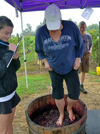 Rochester Women Making Wishes volunteers really got into the grape stomping action on Oct. 5 at Casa Larga Vineyard in Fairport.