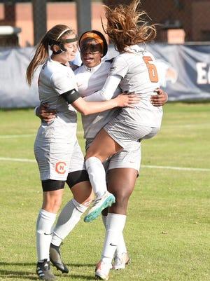 Holly Talbut-Smith, Magda Mosengo and Alex Brandan celebrate Carson-Newman's 2-0 national quarterfinal win against West Florida.
