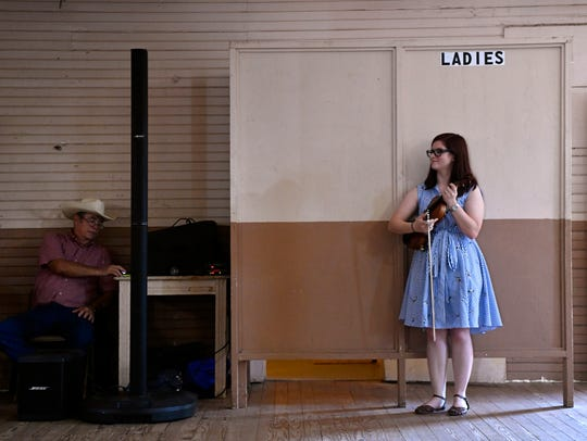 Madison Middle School music teacher Candi Ice waits her turn to perform during the Old Timers Fiddler's Contest at Stamford's Texas Cowboy Reunion.