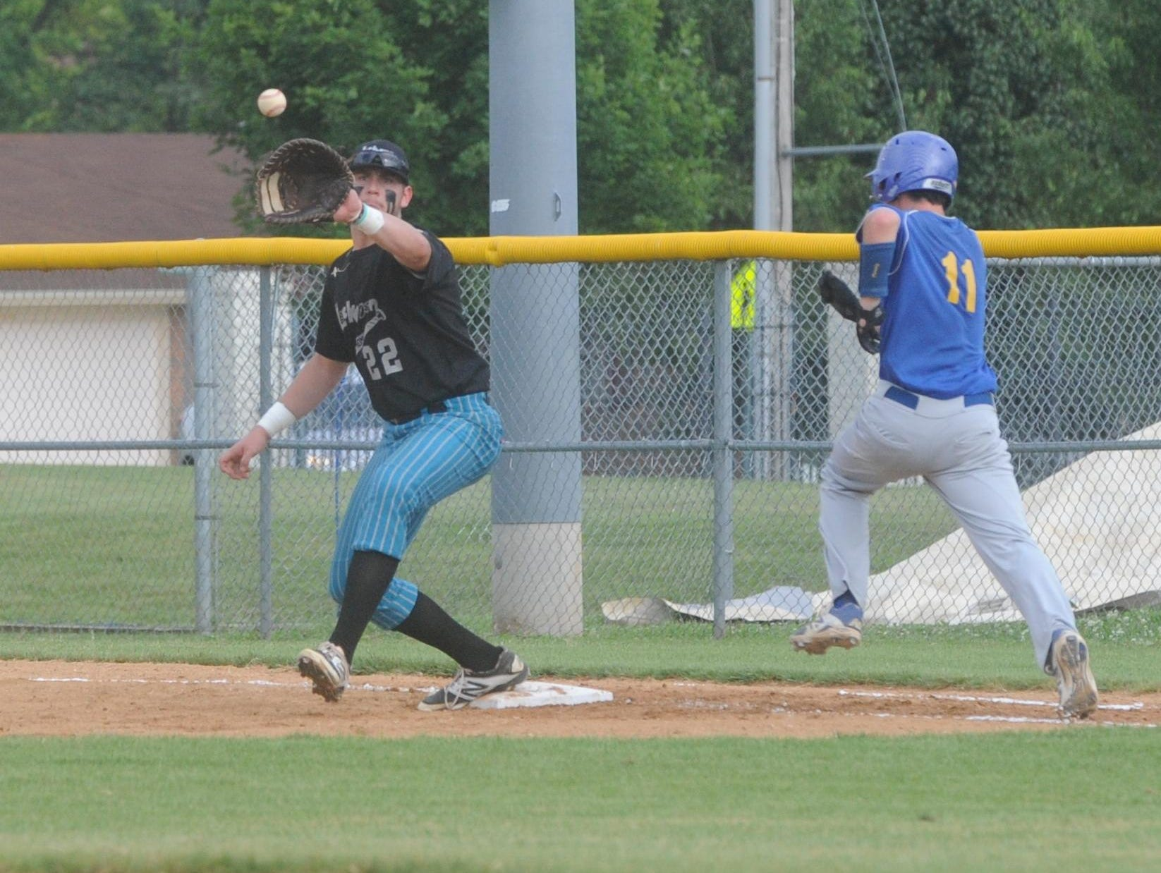 Lockeroom first baseman Sky-Lar Culver receives a throw during a game earlier this season at Cooper Park. Culver will play college baseball at the University of Central Arkansas in Conway.