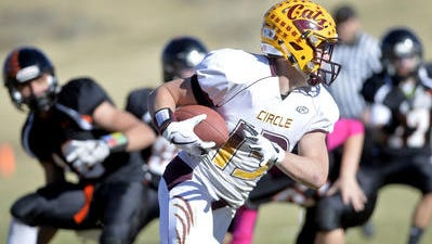 Circle's Calder Fleming carries the football during Saturday's playoff game against Centerville.