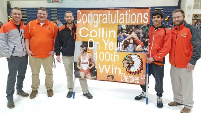 Cherokee assistant coaches, from left, Christian Scannell, Brian Lussier and Mike Zeckman, and head coach Mike Booth, right, recognize junior 113-pound wrestler Collin Wickramaratna for his 100th career win Wednesday at the Region 7 tournament in Toms River.