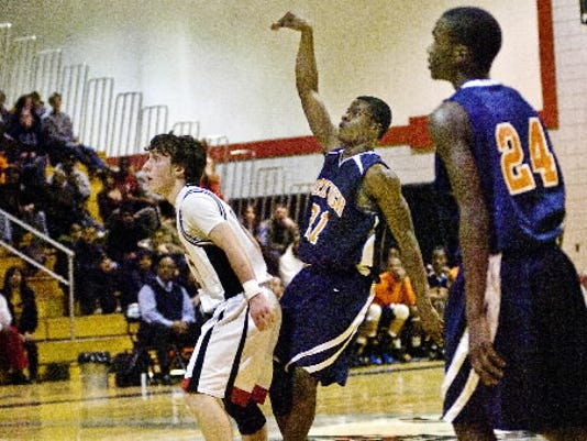 Kelvin Parker, center, last played with his brother Tavon, right, in 2011 while guiding William Penn to a district championship. Kelvin, who transferred from Mount St. Mary's, will join Tavon at Millersville. (GAMETIMEPA.COM -- FILE)