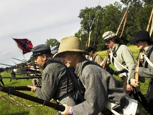 Confederate re-enactors charge and yell the rebel yell before battle in Gettysburg on July 4, 2009. (DAILY RECORD/SUNDAY NEWS -- FILE)