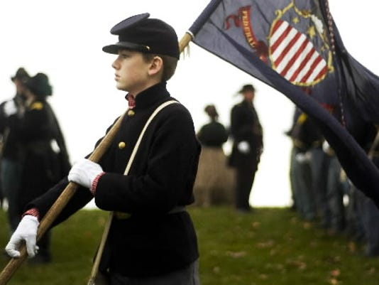 Mark Blumberg of North East Maryland, part of the 7th Maryland re-enactment group, prepares to march through Gettysburg during the annual Remembrance Day Parade in 2009. (FILE PHOTO)