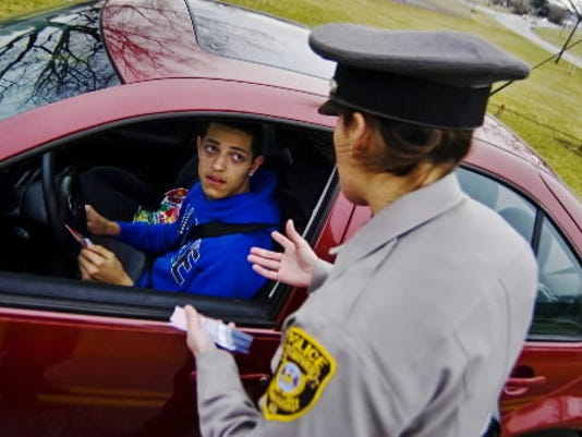 In this photo from 2012, Jordan Banks, then a senior at Hanover High School, talks with Hanover Police Officer Kelly Brubaker during a Hanover Police Departments seat belt safety check. (File photo from the Evening Sun)