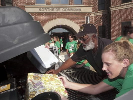 Becky Groft, right, and other members of the York College Move-In Team unload the car of Santford Morris of Willingboro, NJ, as his granddaughter and others move into a dorm in 2011. (File photo)