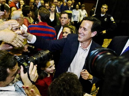 One picture of Santorum Brett filed Tuesday night. If you notice notice the angle of the shot, and you know Brett, you'd realize it's his picture without me having to tell you. Photo rule: When there's crush of press, send the tall guy.
