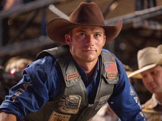 """In this image released by 20th Century Fox, Scott Eastwood portrays Luke, a former champion bull rider looking to make a comeback, in a scene from """"The Longest Ride."""" (AP Photo/20th Century Fox, Michael Tackett)"""