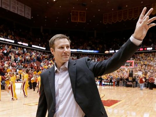 File- This Jan. 17, 2015, file photo shows Iowa State coach Fred Hoiberg waving to fans as he walks off the court after his team's NCAA college basketball game in Ames, Iowa.