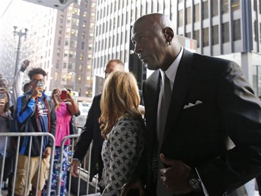 Basketball Hall of Famer Michael Jordan arrives at the federal courthouse in Chicago, Tuesday, Aug. 18, 2015.
