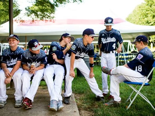 The Red Land Little League team waits for the beginning of the Little League Grand Slam Parade in Williamsport on Wednesday., Pa.
