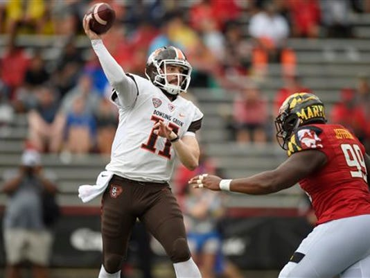 Bowling Green quarterback Matt Johnson (11) passes against Maryland defensive lineman Quinton Jefferson (99) during the second half on Saturday in College Park, Md. Bowling Green won 48-27.