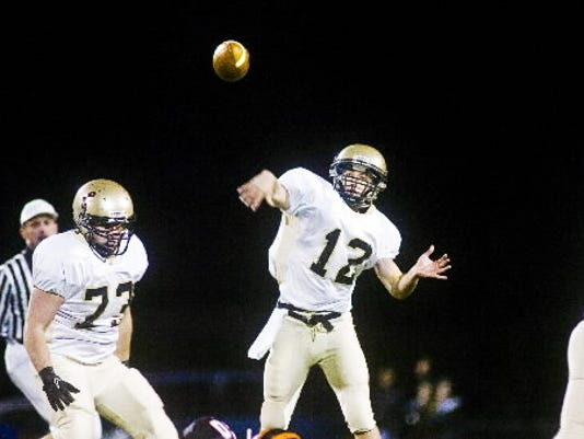 Delone Catholic quarterback Brett Smith fires a pass during a game against Hanover last season.