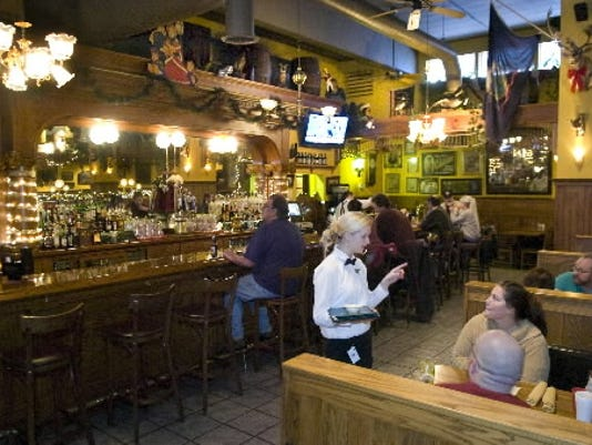 The bar back at the restaurant is made of hand-carved wood from the late 1800s, said general manager Athena Kearis.