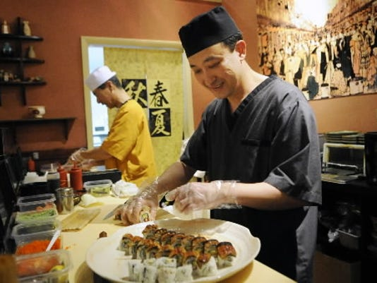 Gi K Kim, left, and Kevin Kim prepare sushi Friday at Kissho Sushi in York.