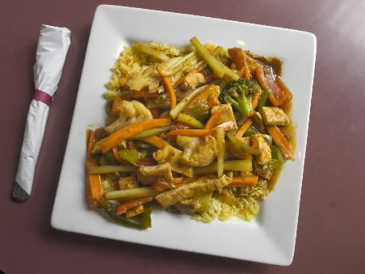 Chicken stir-fry sells for $7.95 at The Chow Down. Prices range between $1.25 and $14.99.